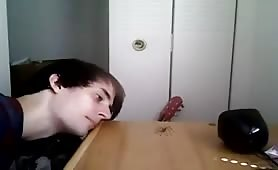 guy eating a live spider