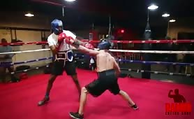 Bodybuilder fighting with a professional boxer