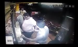 Shooting a fat man at a hot dog stand