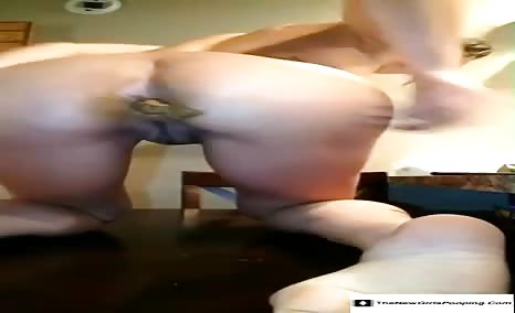 College girl shitting on a wooden table