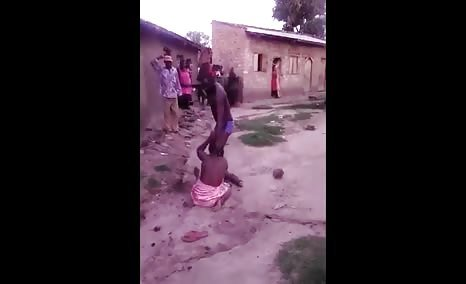 Wife beating her husband with a machete