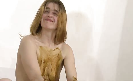 She's masturbating with poop