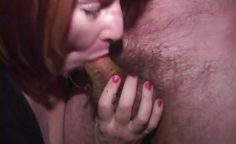 Redhead babe sucking cock
