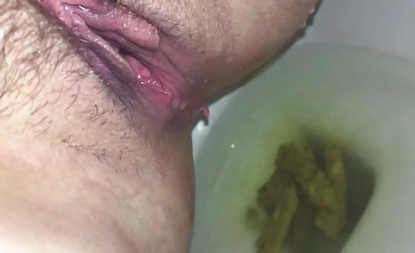 Shaved girl shitting