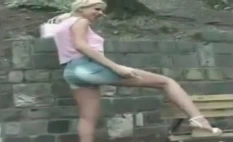 Blonde girl peeing and shitting outdoor