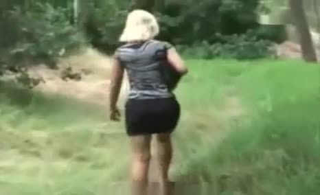 Spying on blonde babe shitting