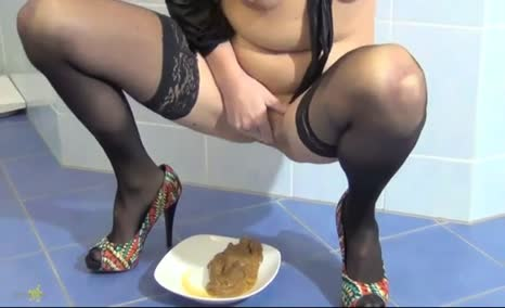Brunette girl shitting and smearing